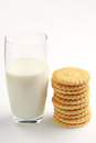 Glass of milk and cookies on white background Stock Images