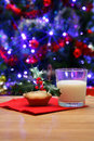Glass of milk and a mince pie for Santa Royalty Free Stock Image