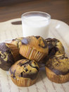 Glass of milk and muffins Stock Photo