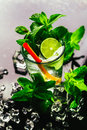 Glass of mojito with lime and mint ice cube close-up red straw Royalty Free Stock Photo