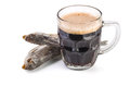 Glass mug with brown ale and dried fish on white background Royalty Free Stock Photos