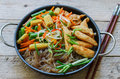 Glass noodles with chicken, green beans, carrots, corn, soya sprouts and greens Royalty Free Stock Photo