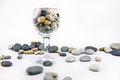 Glass with ocean rocks on white background Royalty Free Stock Photo