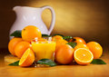 Glass of orange juice with fresh fruits on wooden table Royalty Free Stock Images