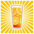 Glass of orange juice with slices and rays Stock Image