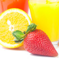 Glass of orange juice, strawberries and  strawberry juice Royalty Free Stock Photo