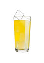 Glass of orange soda drink cold with ice cubes