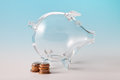 Glass piggy bank with coins Royalty Free Stock Photo
