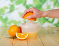 Glass and pitcher of orange juice on wooden table green background Royalty Free Stock Image