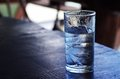 Glass of plain water with ice on the table Stock Photo
