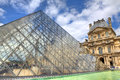 Glass Pyramid and Louvre Royal Palace. Royalty Free Stock Image
