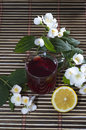 Glass of red tea, nearby lemon and flower Royalty Free Stock Photo