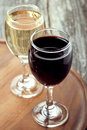 Glass of red and white wine on a wooden board top view Stock Image