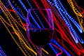 Glass of red wine on background of abstract colored lights in motion Royalty Free Stock Photo