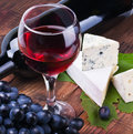 Glass of red wine with bottle Royalty Free Stock Photography