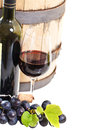 Glass red wine bottle barrel grapes isolated white Royalty Free Stock Photos