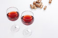 Glass of red wine and corks  on white background. Royalty Free Stock Photo