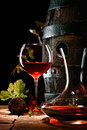 A glass of red wine next to a decanter Royalty Free Stock Photo