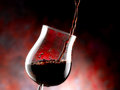 Glass of red wine poured Royalty Free Stock Photography