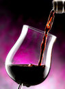 Glass of red wine poured Royalty Free Stock Images