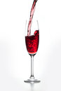 Glass of red wine poured out isolated on gray background Stock Images