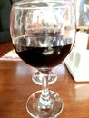 Glass of red wine on the table photo Royalty Free Stock Photo