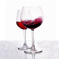 A glass of red wine on white background Stock Photos