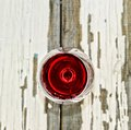 A glass of red wine on a white vintage board