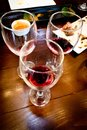 Glass of red wine after wine testing party. Royalty Free Stock Photo