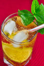 Glass of refreshing drink and mint in a with lemon ice cubes Royalty Free Stock Photography