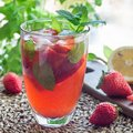 Glass of iced tea with strawberries and mint, square Royalty Free Stock Photo