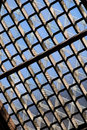 Glass roof a lattice pattend and wood with blue sky Royalty Free Stock Image