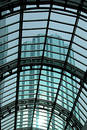 Glass Roofing with skyscraper Royalty Free Stock Photo