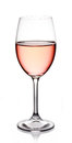 Glass of rose wine on white background Royalty Free Stock Photos