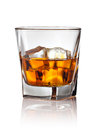 Glass of scotch whiskey and ice on a white background Stock Photo