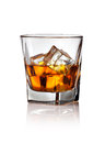 Glass of scotch whiskey and ice on a white background Stock Photos