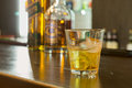 Glass of scotch or whiskey on the rocks Royalty Free Stock Photo