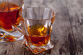 Glass of scotch whiskey on a wooden table Stock Image