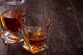 Glass of scotch whiskey on a wooden table Royalty Free Stock Images