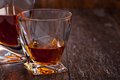 Glass of scotch whiskey on a wooden table Royalty Free Stock Image