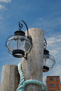 Glass seafaring lamp a large period on a weathered post on a coastal maine dockside Stock Images