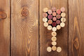 Glass shaped wine corks over rustic wooden table background Royalty Free Stock Photo