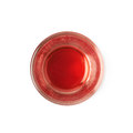 Glass shot with grenadine leftovers red syrup isolated over the white background Stock Photos