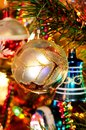 Glass silver and white christmas bauble globe hanging on a tree Stock Photos