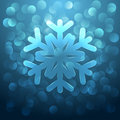 Glass snowflake christmas background with and glare on blue Royalty Free Stock Image