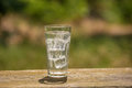 A glass of soda water on an old board, on the nature Royalty Free Stock Photo