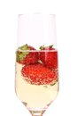 Glass of sparkling wine and strawberry isolated on white background Stock Photos