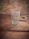 Glass and spider web dirty old with inside on wooden background Royalty Free Stock Photo
