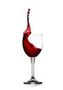 Glass of splashing red wine isolated on white Royalty Free Stock Photo