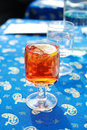 A glass of spritz aperol aperitif on blue table cloth italy Stock Photo